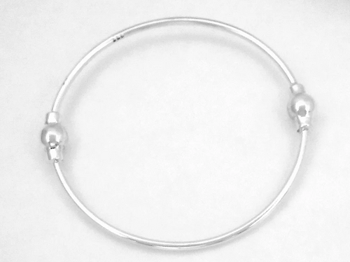 silver bangle with two fixed balls