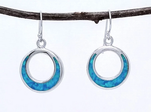 sterling silver circular earring with inlaid simulated blue opal