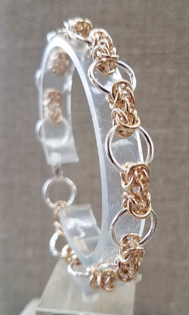 silver and gold interlocking rings link bracelet