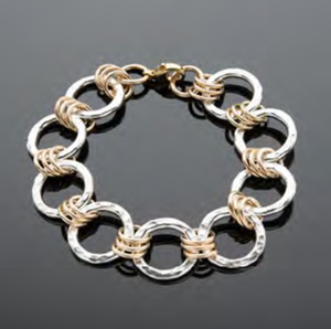hammered silver circle and gold link bracelet