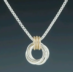 silver and gold interlocking rings necklace