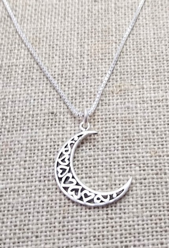 A sterling silver crescent moon with 5 hearts filling it in. Each heart alternates direction.