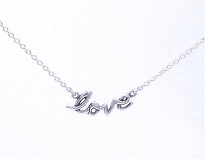 "sterling silver necklace with ""love"" written in cursive font. a rolo style chain is attached to either end of the word."