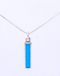 Solid color turquoise bar set vertically in sterling silver. A silver jump ring connects it to an 18 inch box chain