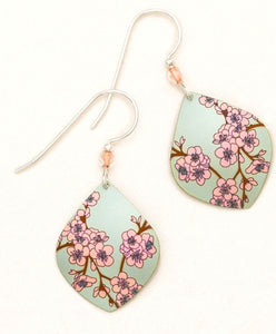 silver earring with pink flowers on light green niobium