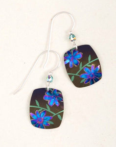 square silver earring with blue flowers on dark background