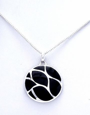 circular silver pendant with 8 pieces of black onyx inlaid.
