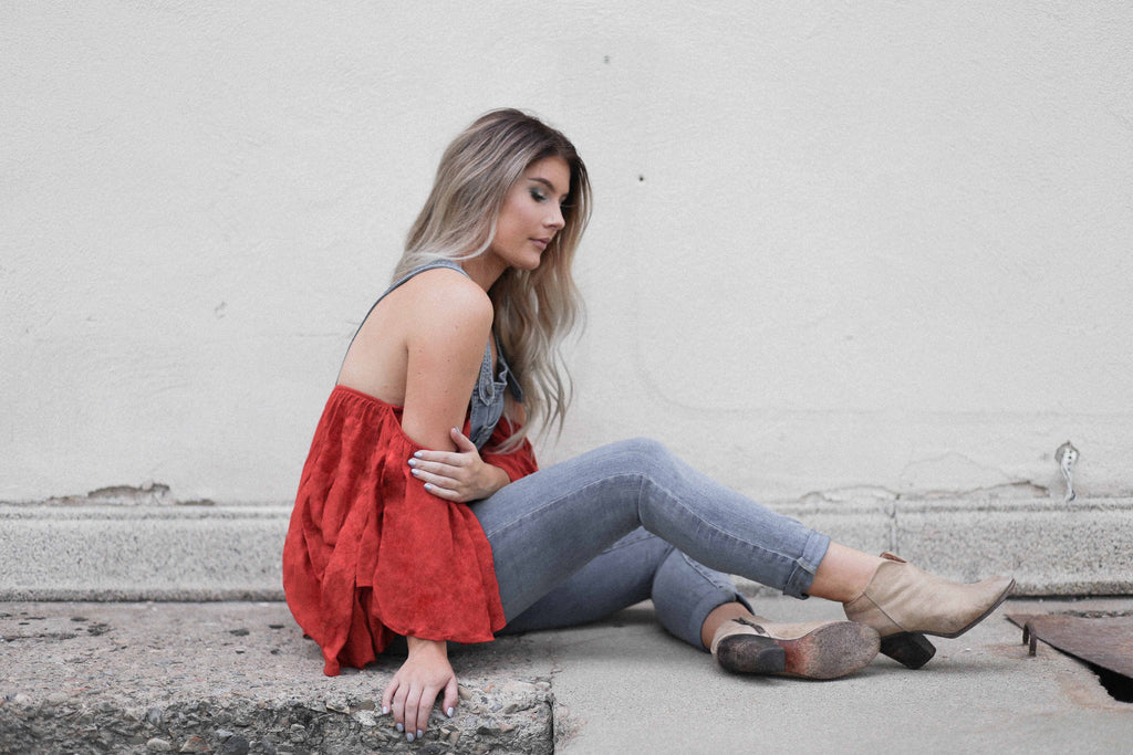 Shae Powder Rose wearing Noa Elle Flounce Ruffle Rumor Top