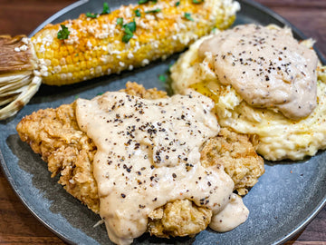 Chicken Fried Steak with Smashed Potatoes & Cracked Pepper Gravy
