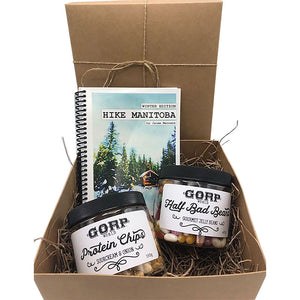 Half Bad Hiking Snack GORP Gift Box.  1 Hike Manitoba Book by Jaime Manness.  1 jar of GORP Protein Chips, any flavor choice, 150g jar.  1 jar GORP Half Bad Beans - Gourmet Jellybeans, 425g jar.