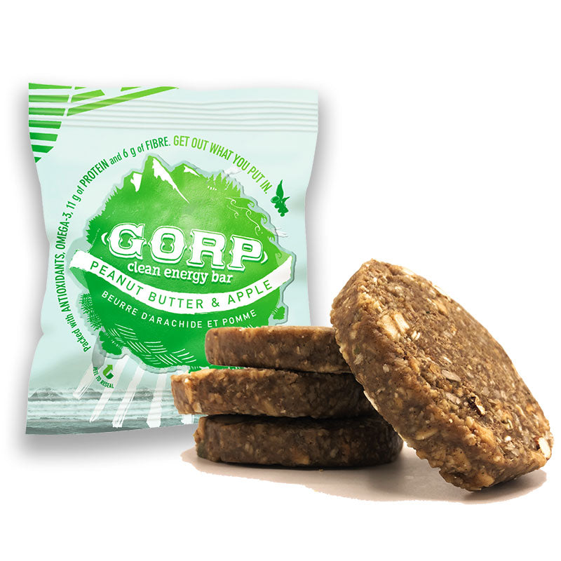 Peanut Butter & Apple GORP Clean Energy Bar, package with green GORP World logo.  Three bars piled up with one resting on the right side, showing the ingredients in the bar. 65g bar
