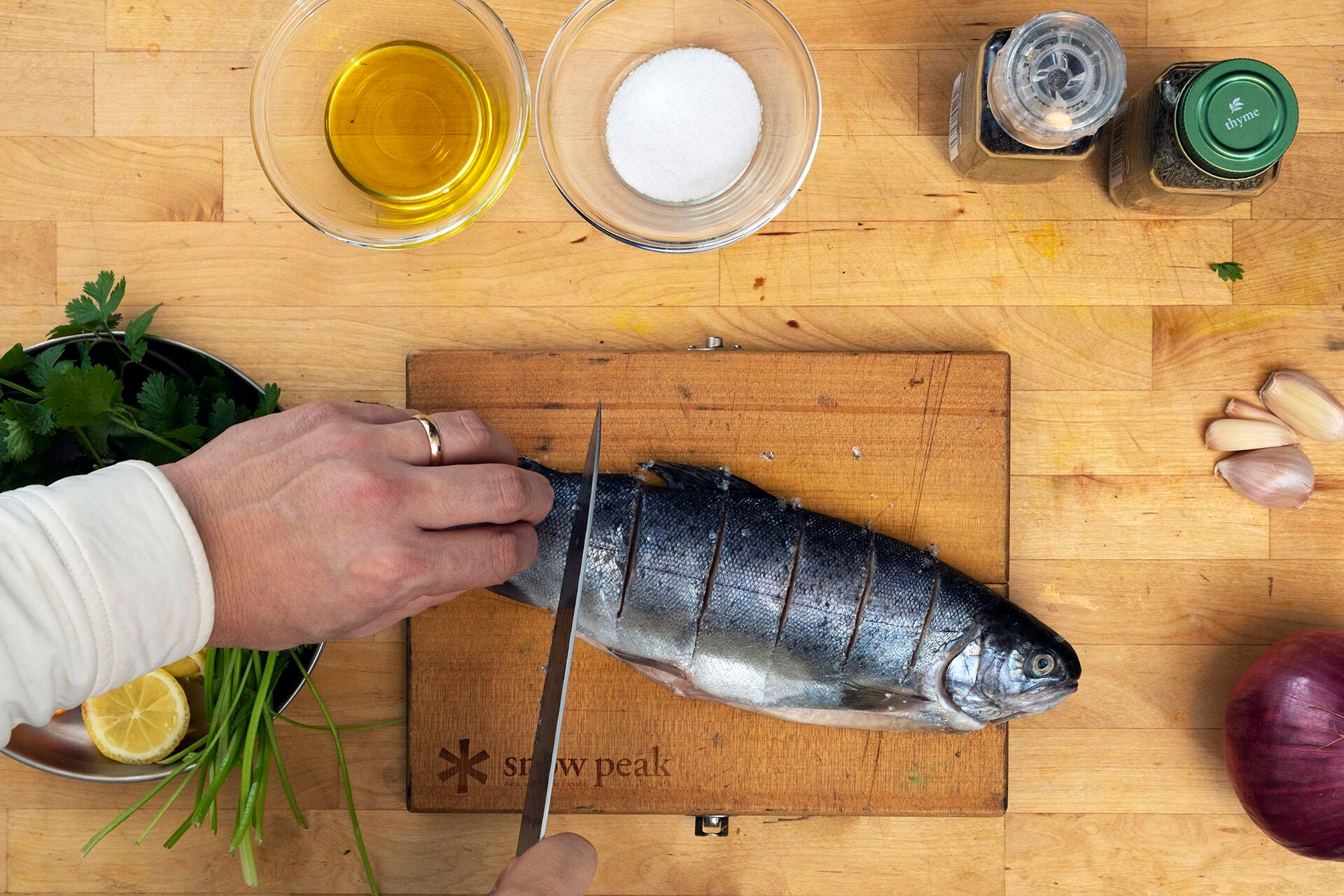 Scoring trout in preparation for grilling