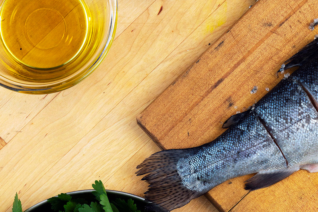 Coat the fish in olive oil and season with salt and pepper