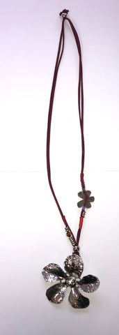 Long flower necklace with maroon leather chain.