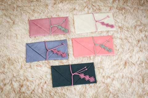 Bojagi wallet in 5 colors out of out 10 color selection. These bojagi wallets are commonly used as  Korean wedding money envelopes.