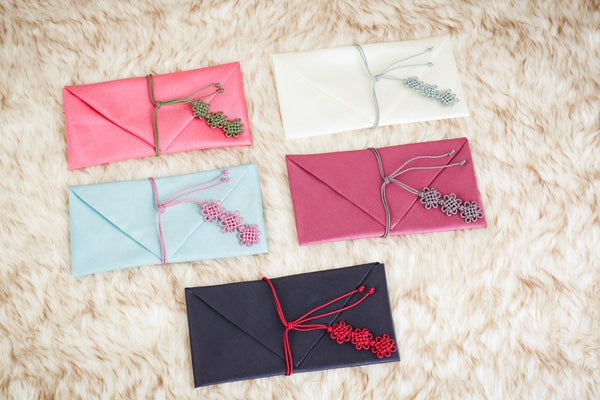 Bojagi Wallet in 5 other colors out of our selection of 10. These Korean made fabric wallets are used for respectfully exchanging money between two family members or friends during a special Korean celebration such as Lunar New Years or a wedding.