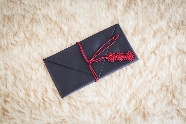 This is a Navy colored bojagi wallet. This color is specifically used for the male side's of the family to give to the spouse's side of the family before the wedding with money and a letter as a form of respect and future relationship.