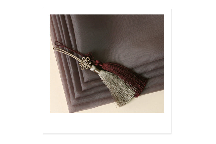 You can see the tassel that adorns the edge of this wrapping cloth to add a decorative touch to the fabric.