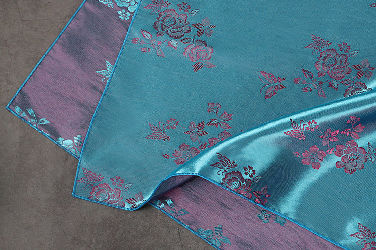 In this up close image, you can see the floral design and how elegant it makes the gift wrapping cloth. The cyan and slate really help the floral design pop.