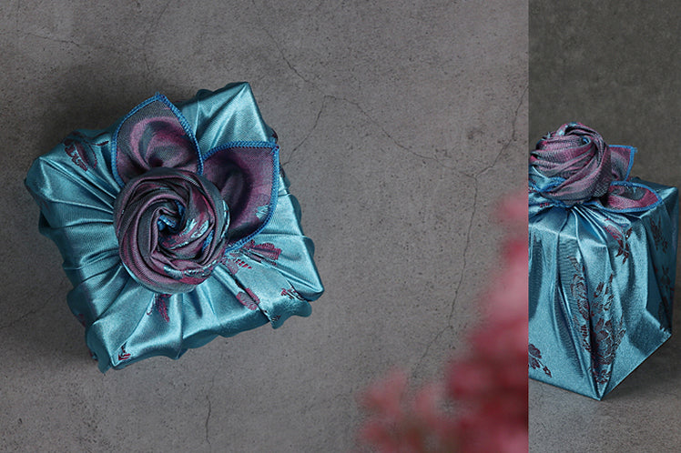 You can take the azure and silver Korean Bojagi wrapping cloth and make any gift look gorgeous, but adding a delicate handmade knot at the top looks even more stunning.