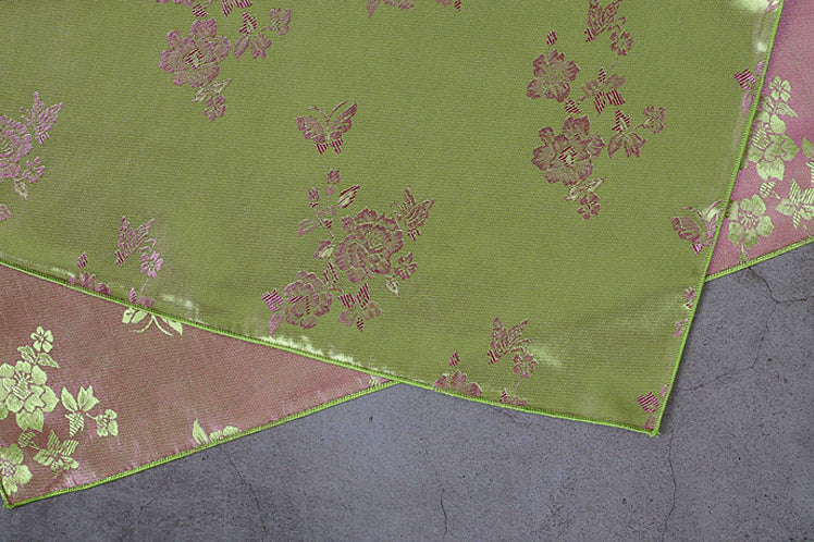 The flowers really seem to look like they are moving with this cerise and sage colored Korean Bojagi fabric cloth.