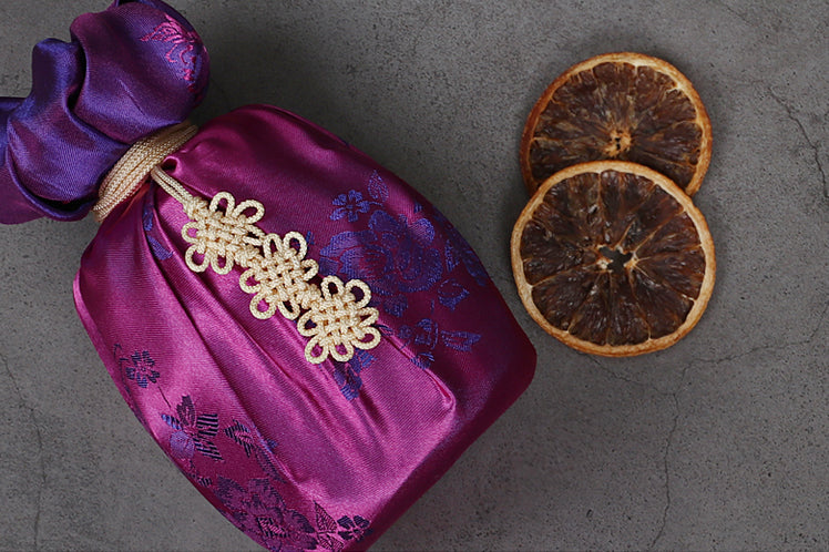 Wrapping presents with fabric allows you to wrap even the hardest presents, such as circular or oblong items. The periwinkle and violet make for a one-of-a-kind gift for that someone special.