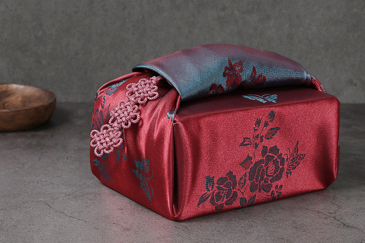 Warm energy and love emanate from this dark crimson and light cyan gift wrapping cloth and it's one of many Bojagi for sale on our website.
