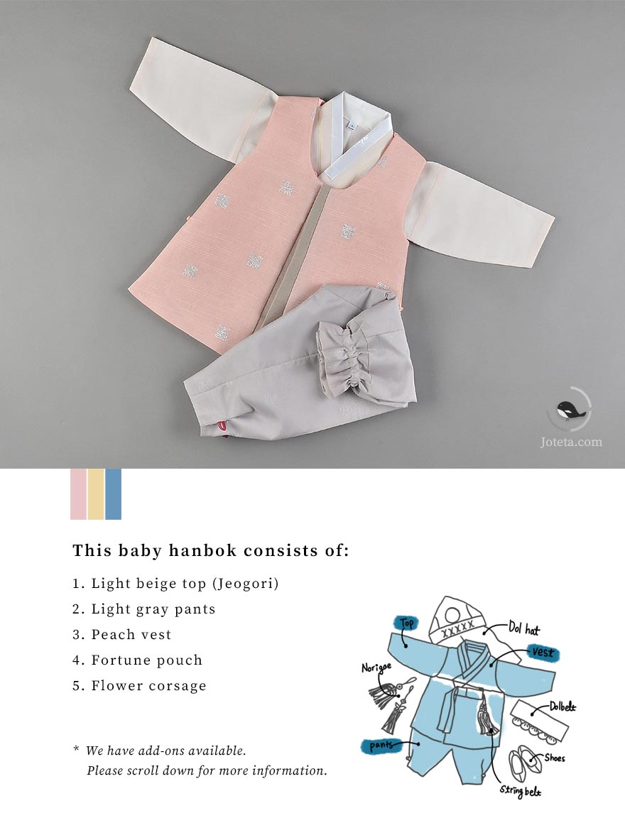 Gray pants and pink top on a baby that's getting ready for his Korean first birthday celebration.