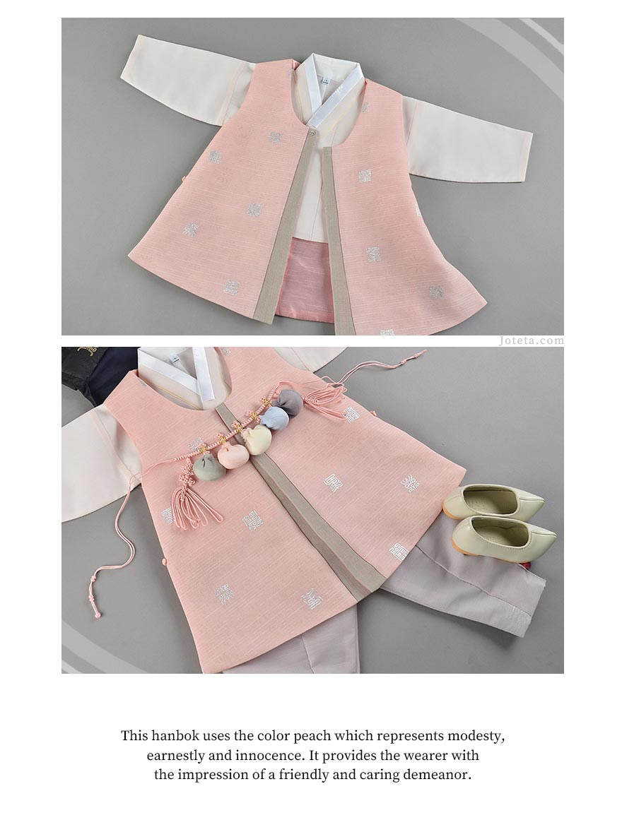 Peach baby hanbok for a 100 day year old baby dressing up for his Baek il which is a 100th day celebration.