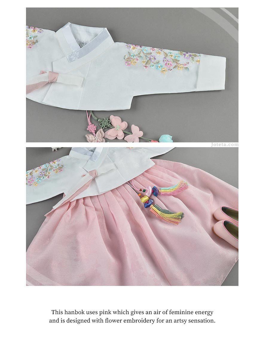 Floral embroidered jeogori of this hanbok paired with a butterfly and traditional Korean norigae.