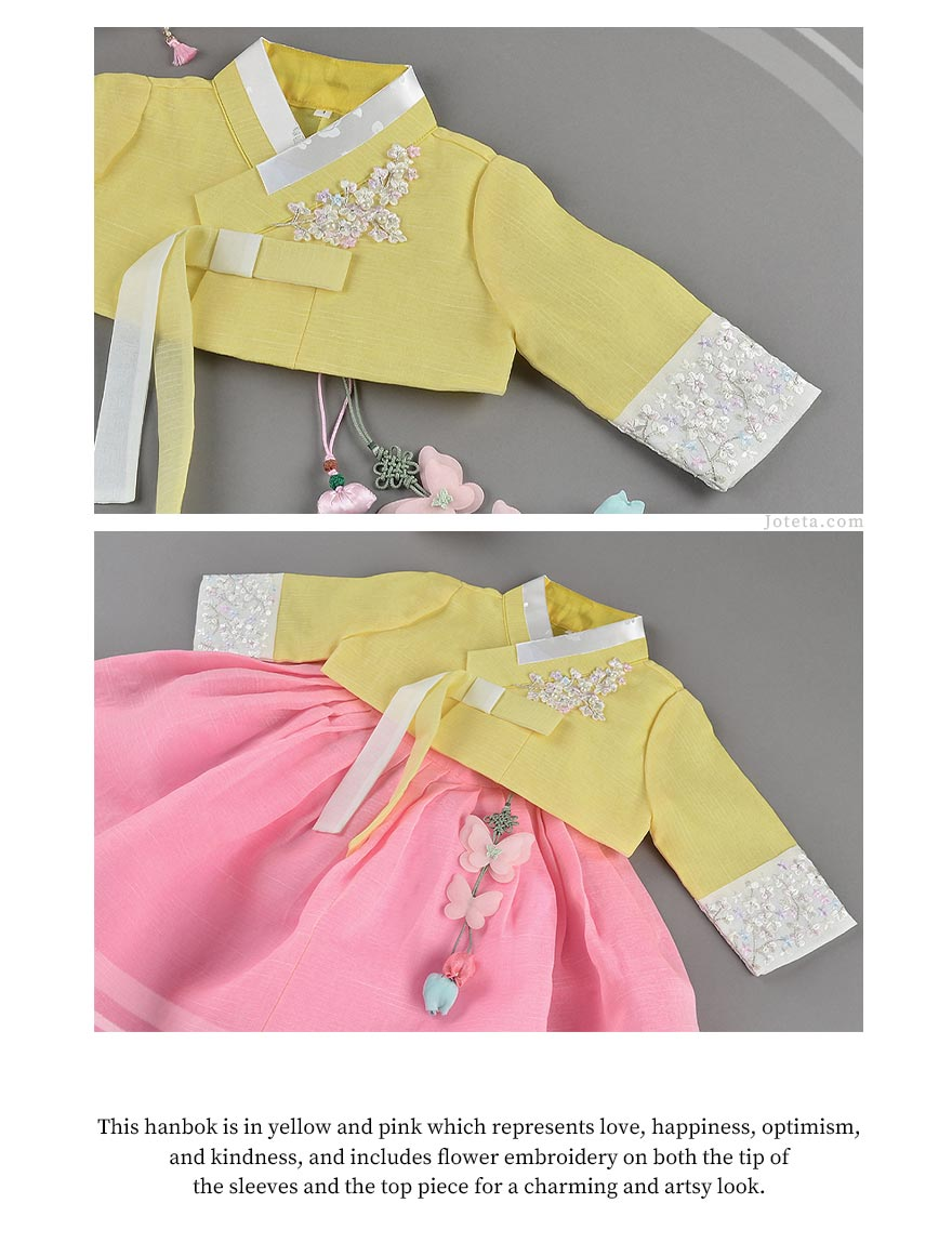 Flowers designed throughout the hanbok. The baby girl is wearing this and examining the beauty of the flowers that is spread across her hanbok.
