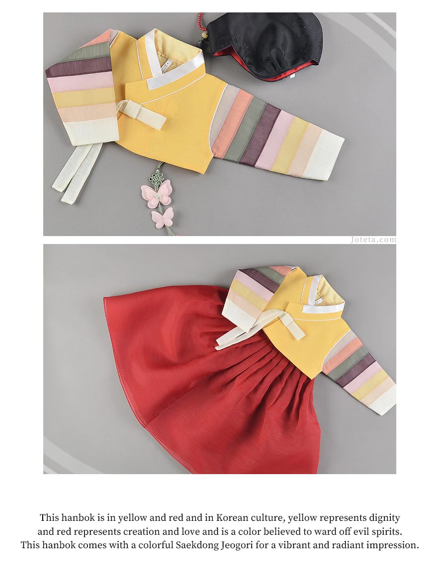 The baby girl hanbok in deep red and dark yellow is eye-catching and will draw attention to the details found on the hanbok.