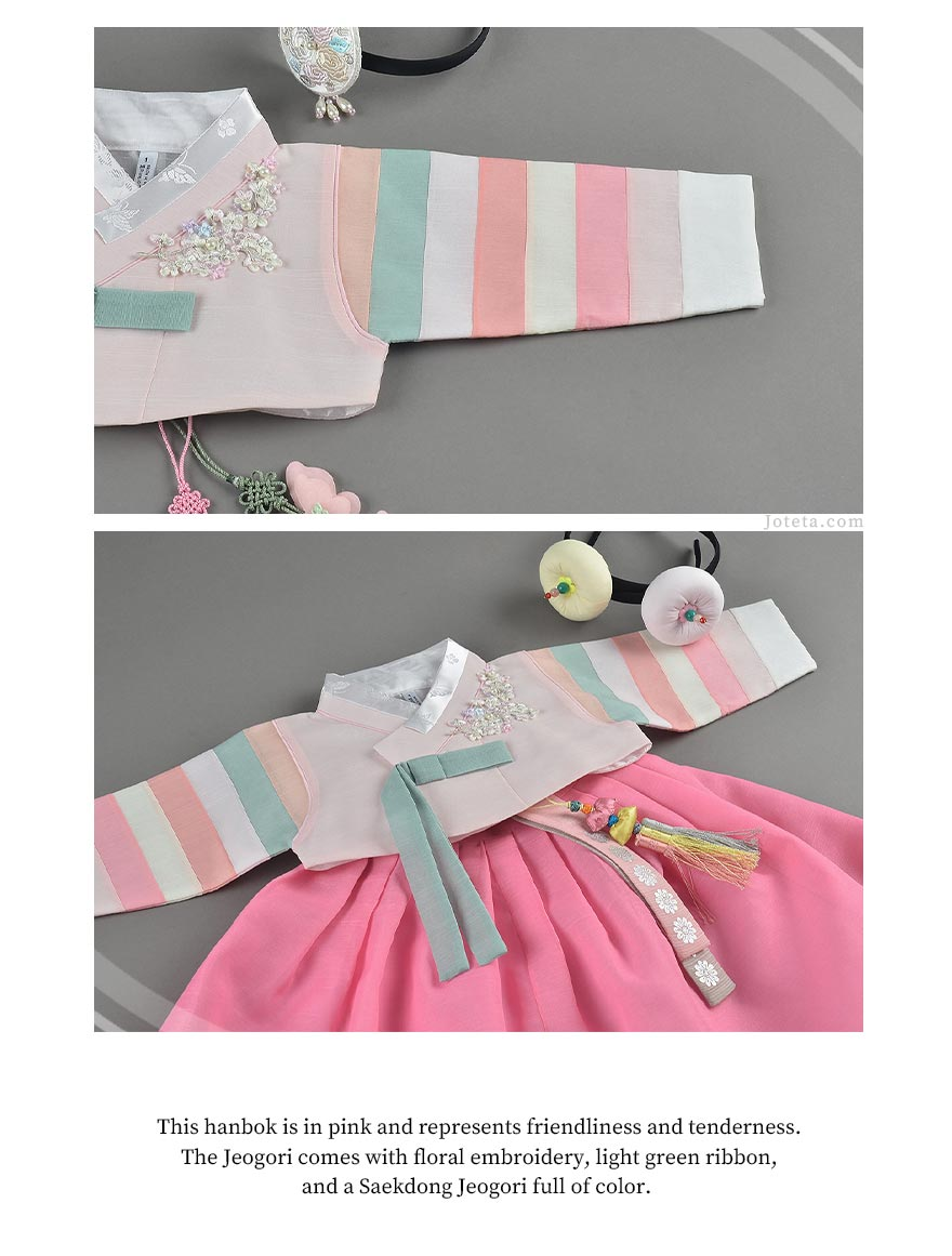 The multicolored sleeves make this baby girl hanbok in blush fun and it will turn heads every time your baby wears it out.