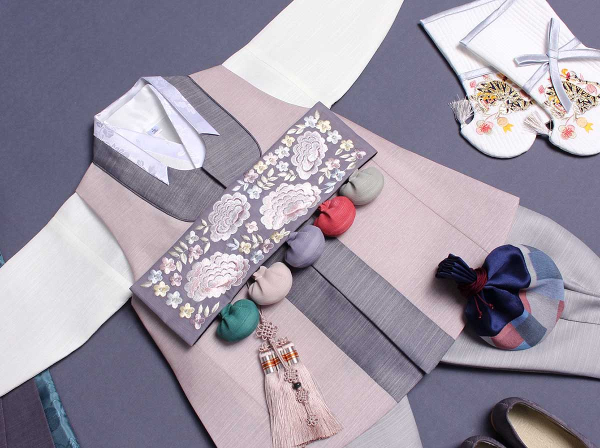 In this view, you can see more of the adorable Baby Boy Hanbok in sand. It's classic and going to bring out the Korean in your baby.