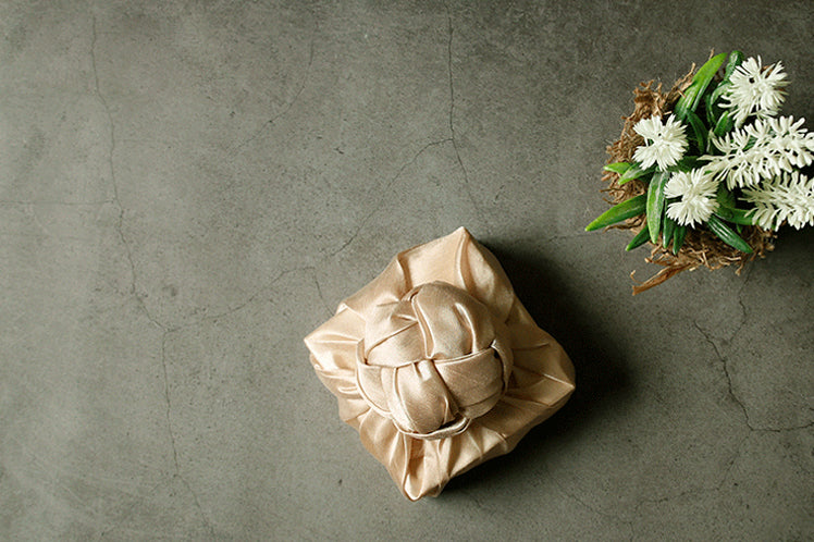 Bojagi gift wrap in cream is an exceptional choice for fabric wrapping paper for a wedding.