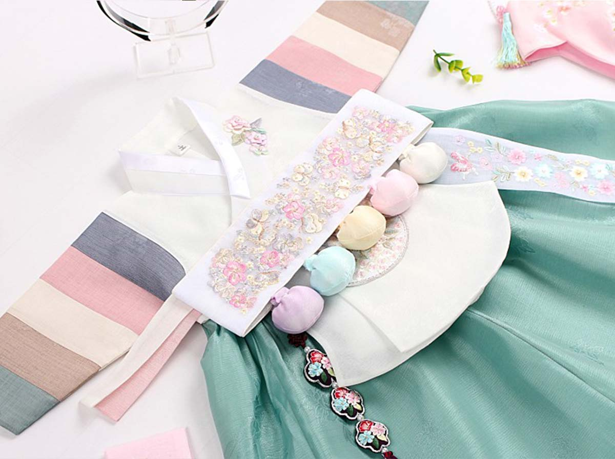 We offer 100 day, 1 year and 2 year baby girl hanbok in alabaster and azure. This is the Dol belt which comes with the baby girl Dol hanbok.