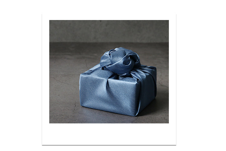 Reusable gift wrap is great because you can save it from a Doljanchi and use it for Christmas, and blue is a very neutral color that adds flair to any event.