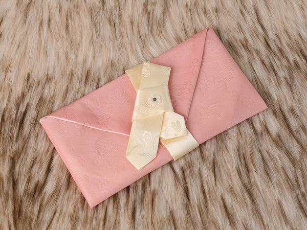 A beautiful silk bojagi Korean money envelope that's in coral.