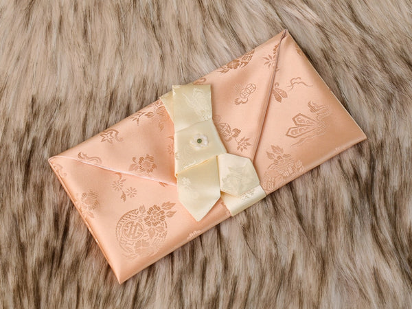 This is a beige colored Korean wedding money envelope made of silk, the same kind used to make hanboks.