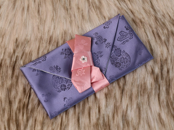 This is a purple Korean money envelope made with silk.