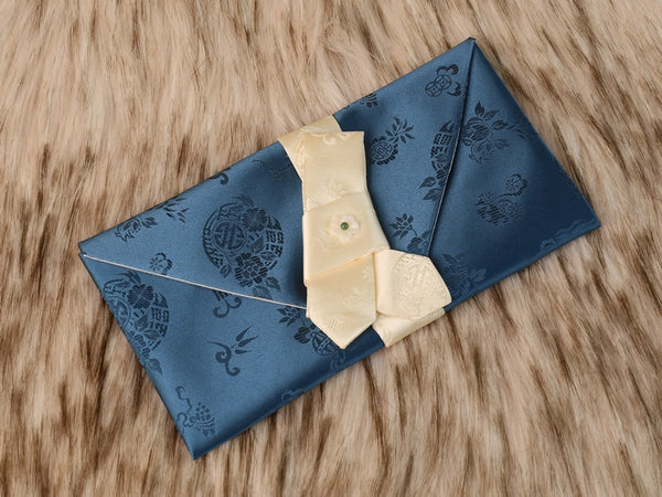 The deep blue cloud crane money envelope is shown below. The picture show the silk fabric and the intricate designs on the wallet.