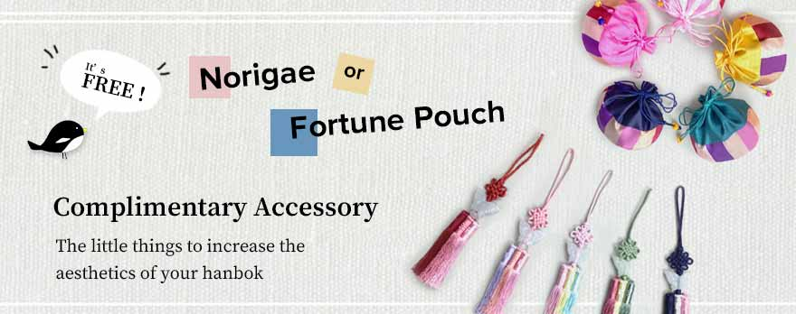 We'll give you a free accessory item for your baby girl hanbok in white and pink short version. Choose either the Fortune Pouch or the Norigae during checkout.