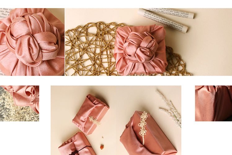 To add a spiffy decoration on the pink gift wrapping cloth, make a bow or knot at the top.