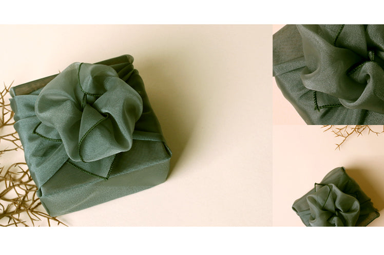 A bow accentuates the jade Bojagi art Korean wrapping cloth and adds some radiance to your gift.