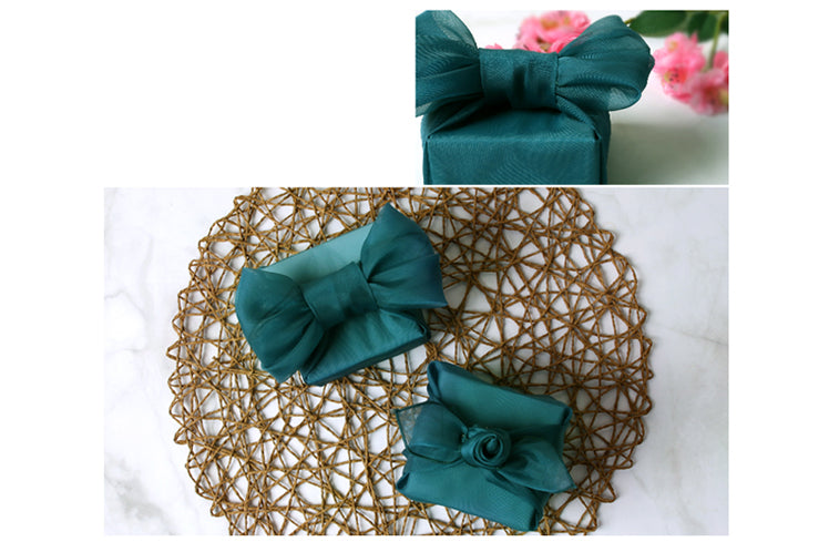 This dark teal lucid Bojagi wrapping is perfect for a baby boy Doljanchi where fabric gift wrapping is essential.