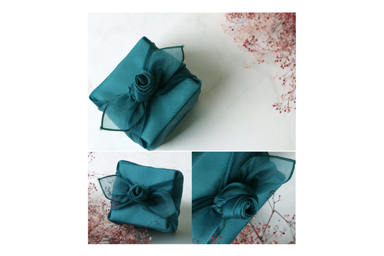It's easy to tie a classy bow using Bojagi wrapping cloth for a marvelous gift-giving experience.