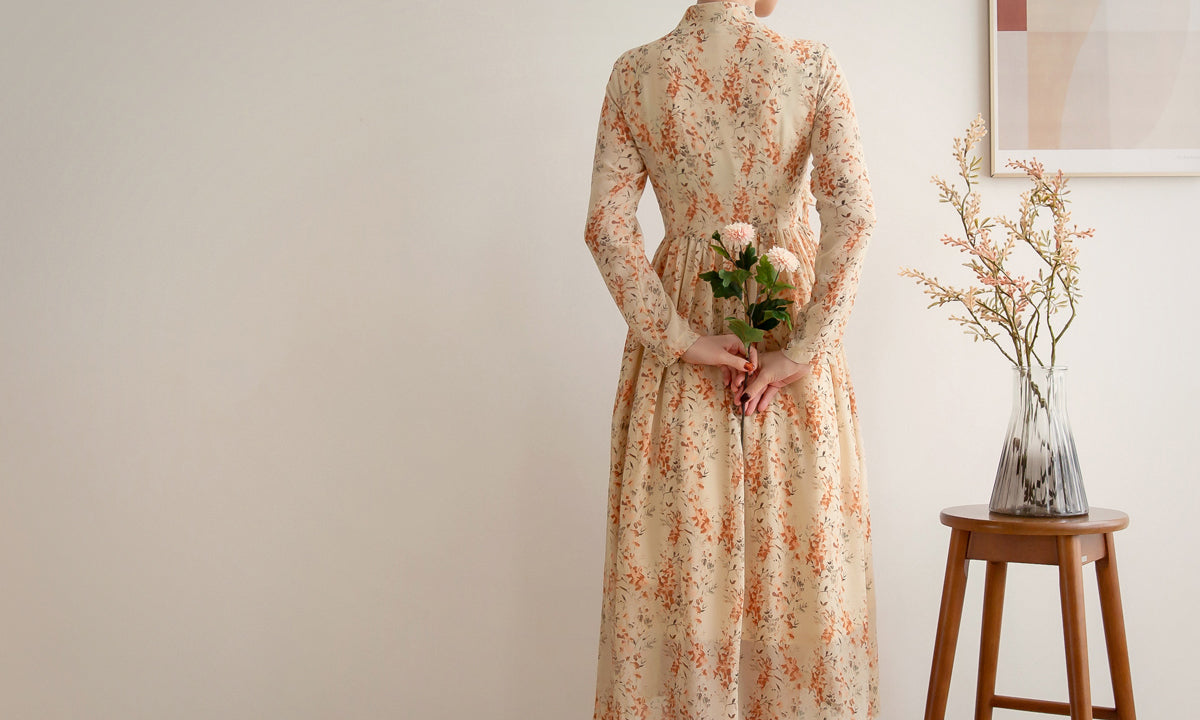 Our modern hanbok dress in cream flower design is ideal for spring and summer and looks striking for any event.