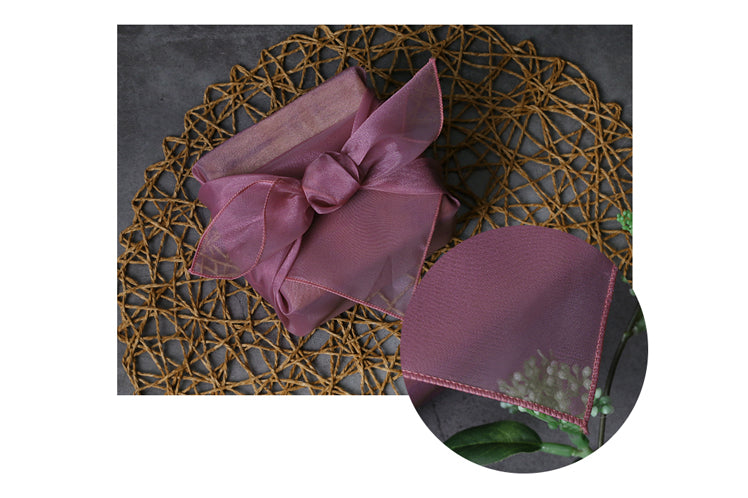 The eye-catching bow at the top of this plum fabric gift wrap makes it idyllic for a Doljanchi.