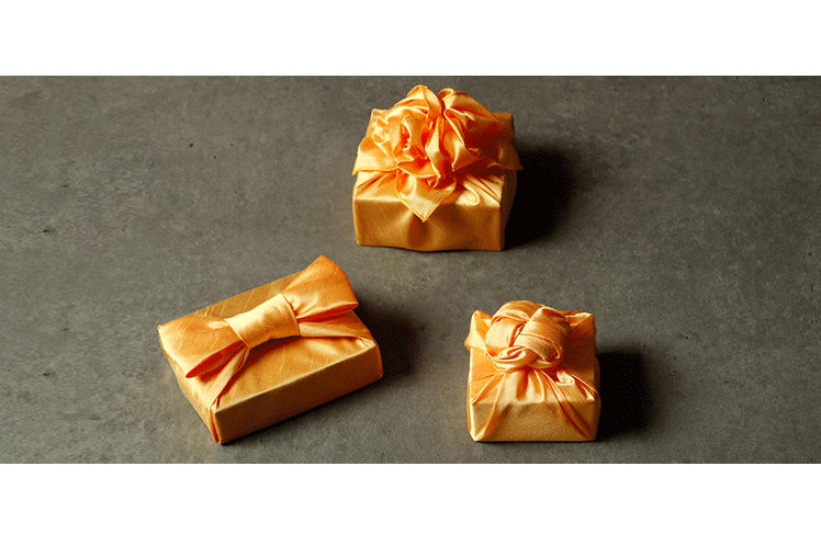 Korean Bojagi for sale comes in many colors, such as this tangerine colored luxury gift wrap.