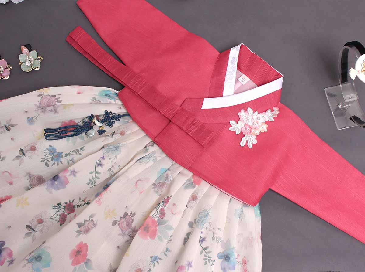 The floral baby girl hanbok in cherry red and cream is so traditionally Korean and authentic to the culture of Korea.